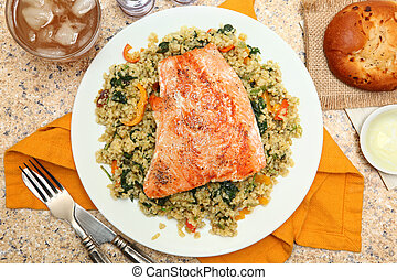 Salmon with Cracked Freekeh Salad at table with spicy salsa...