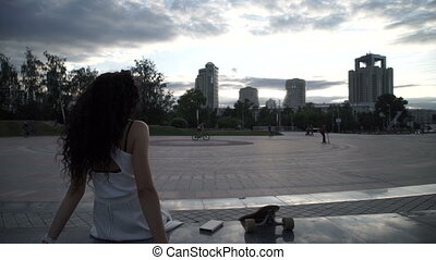 Woman on background of city