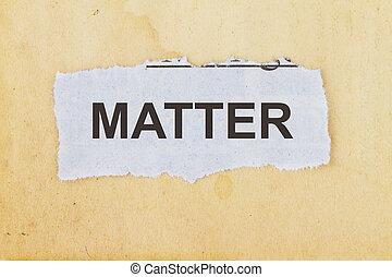 Matter - matter concept- newspaper cutout in an old paper...