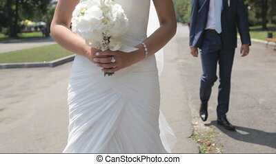 beautiful newlyweds in love in the park. - beautiful couple...