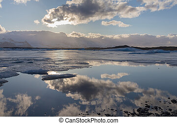 Iceland winter lagoon with blue sky reflection, natural...