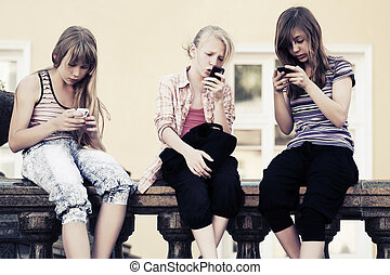 Teenage girls calling on the cell phones