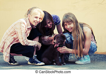 Teenage girls with a puppy