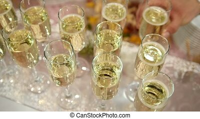 Catering on event - glasses of champagne on the table, close...