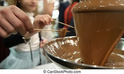 Catering on event - chocolate fountain people use chocolate...