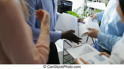 Business People Group Reading Report Documents While...