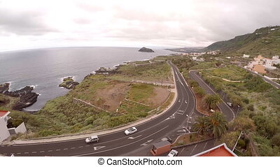 Aerial photography of motorway near and sea coast of...