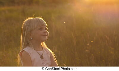 Happy little girl at sunset - Cute little girl at the meadow...