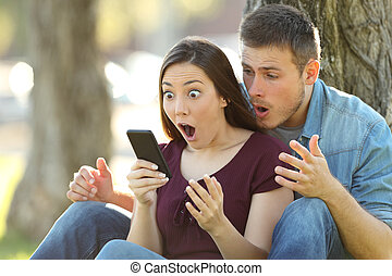 Surprised couple finding amazing content on line