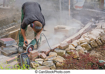 Craftsman works with an electric grinding machine