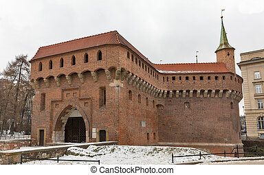 Military building Barbican at winter in Krakow, Poland. -...