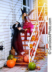 trick or treat - Happy children in a costumes of witches and...