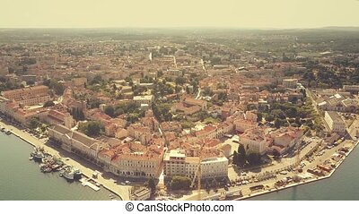 Aerial establishing shot of the ancient city of Pula,...