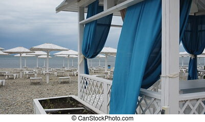 Blue curtains fluttering in the wind. - Blue curtains in a...