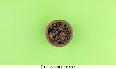 Zoom of a clay pot filled with coffee bean. Isolated green...