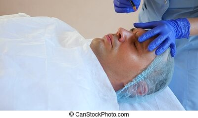 Spa therapy for handsome men receiving facial mask. 4k. Slow...
