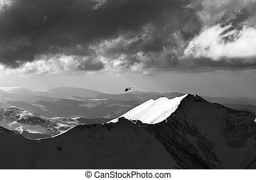Black and white view on off-piste slope for heliskiing and...