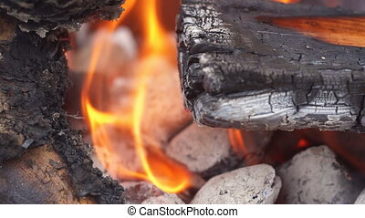 fire wood for barbecue charcoal Slow Motion Closeup of a...