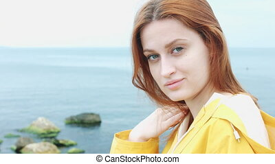 Woman looking at camera and smiling. - Beautiful woman with...