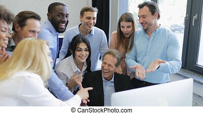 Happy Business People team Discussing Results Of Startup On Computer, Successful Boss With Colleagues Cheerful Looking At Monitor Talking