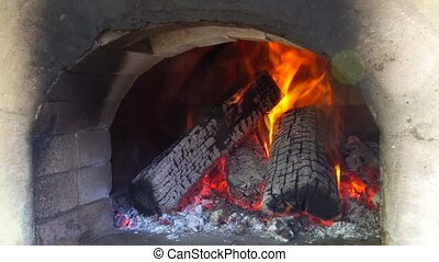 Glimpse wood fire oven before the pizza comes in - Glimpse...
