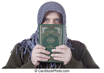 Muslim man with the Koran in their hands