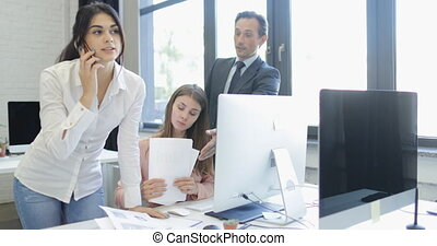 Young Businesswoman Talking On phone Call Walk From Business People Group Working With Documents In Modern Office