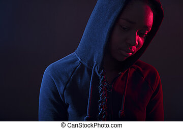 Colorful portrait of thoughtful woman with dark skin wearing...