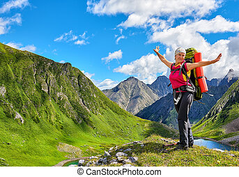 Happy hiker on top of hill in Siberian mountains. East...