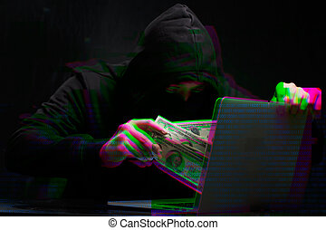 Thief in black with laptop, - Photo of thief in black with...