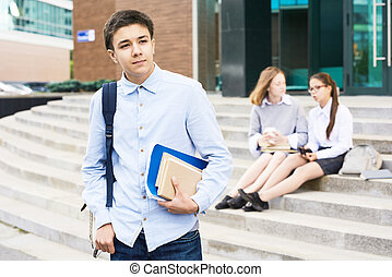Clever Schoolboy Posing Outdoors