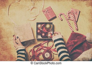 Female hands wrapping a gift - Female hands are wrapping a...