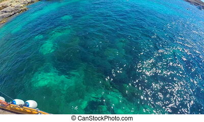 Turquoise clear water behind board the yacht. - Turquoise...