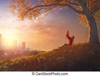 girl walking in autumn park - Cute little happy girl walking...