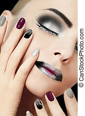 Black silver fashion glamorous manicure and makeup.