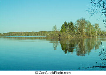 Evening view of Lake with reflection of trees in the water.
