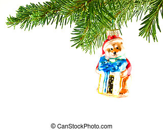 Christmas Tree Holiday Ornament Hanging from a Evergreen Branch Isolated
