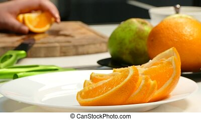 Laying out slices of orange on a plate