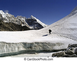 Crossing a glacier atop the Cho La Pass in the Himalaya, Nepal.