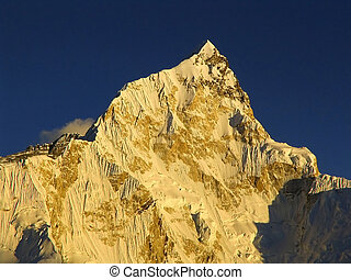 Snow capped peak Nuptse sits just next to Mt Everest in the Himalaya, Nepal.