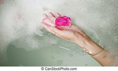 feet girl lying in a round bath with foam