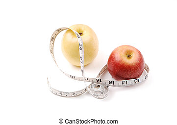 Apple and measuring tape - A yellow and a red apple with a...
