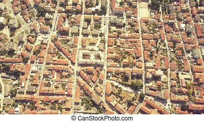 Aerial shot of the blocks pattern in the city of Pula,...