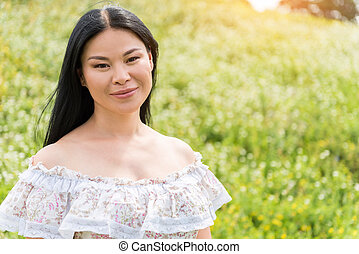 Carefree lady relaxing on flower field