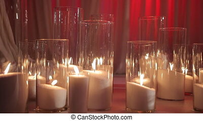 Candles in Glass on the Floor With White Fabric