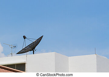 Antenna and satellite dish on the top of the building in the...