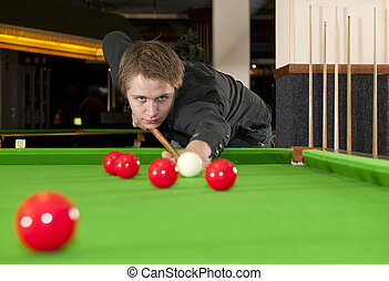 Snooker - Man, dressed in a black shirt, playing snooker
