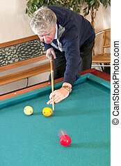 Billiards - Senior man playing carambole billiards - slight...