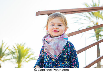 Portrait cute little girl in spring or summer day. -...
