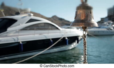 Emergency Bell - Bell in emergency on a background of yachts